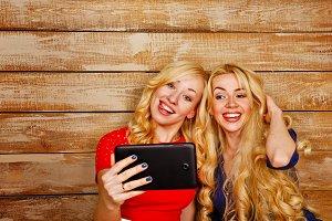 Sisters communicate. Selfie.