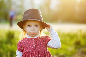 Cute little girl in hat. Spring.