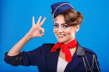 Stewardess with face art shows OK.