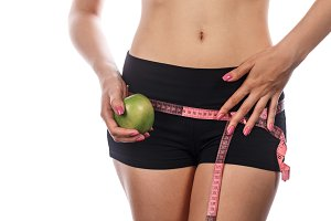 Girl holding apple. Weight loss.