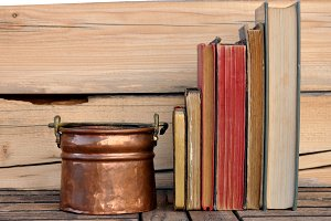 copper cualdron and books