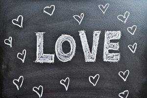Love and hearts on a blackboard