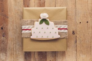 Present gift on wooden background