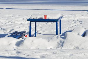 Blue table standing in the snow