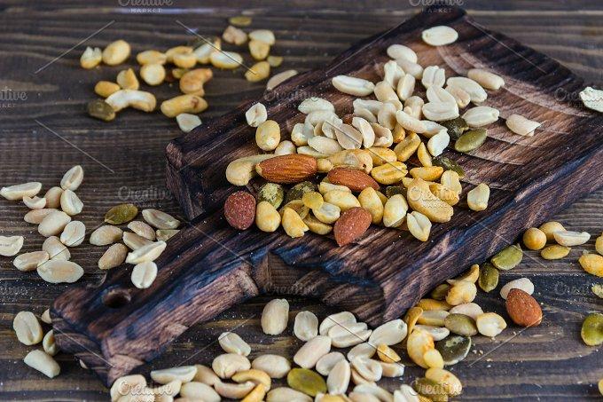 Scatterede nuts. Wooden background - Food & Drink