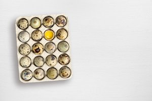 Quail eggs on white wooden table