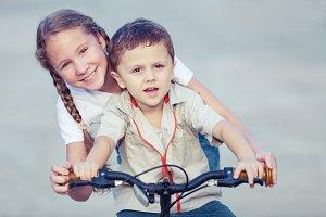 Happy kids with bike