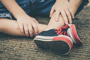 youth sneakers on boy legs