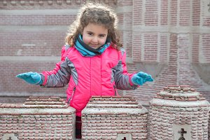 Girl and brick construction
