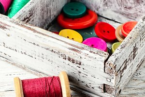 Buttons and spool of thread
