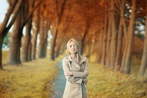 girl walking in the autumn park
