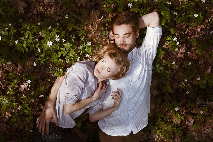 couple on the field with snowdrops - Beauty & Fashion