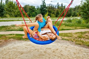 Best girlfriends ride on a swing.
