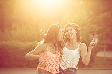 Best girlfriends hug. Sunset.