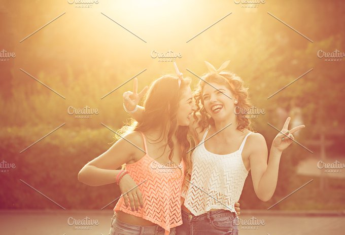 Best girlfriends hug. Sunset. - People