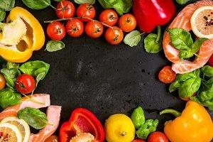 Salmon steaks and fresh vegetables