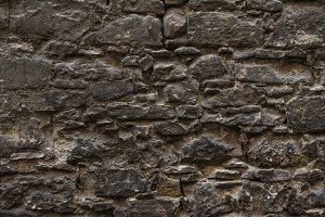 Old medieval natural stone wall