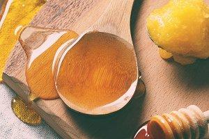 Honey on wooden chopping board