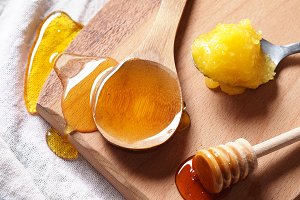 Honey on wooden chopping board
