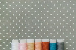 background with thread spools