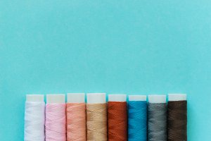 thread spools with blue background