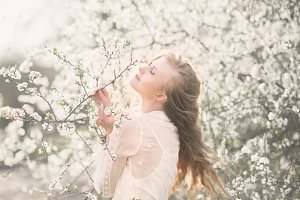 girl near blossoming tree