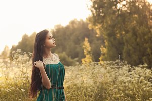 Girl in dress on nature