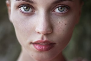 close portrait of green-eyed girl