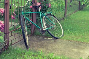 old bicycle near the gate