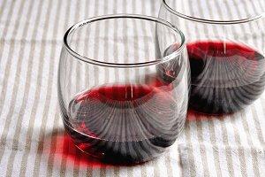 Red wine in glasses. Square image