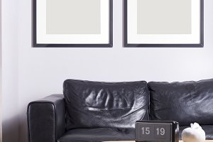 Picture frames hanging on white wall
