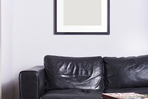 Picture frame on wall with sofa