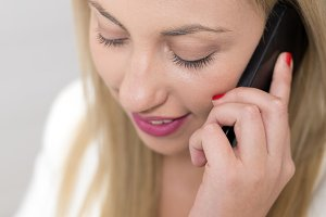 Attractive young woman talking on phone