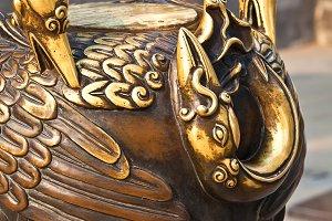 Bronze chinese herons