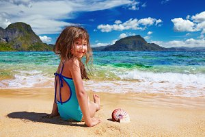 Small girl on the tropical beach