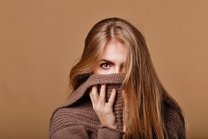 Girl wrapped in a warm sweater