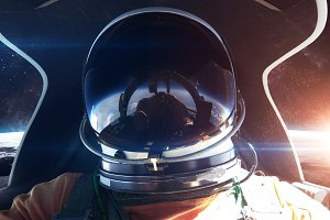 Brave astronaut in the spaceship cabin. This image elements furnished by NASA
