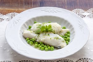 Bacalao al pil pil with peas