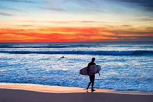 Surfer at beautiful sunset