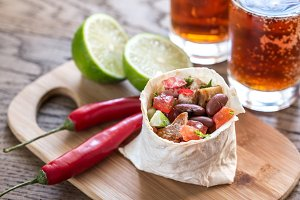 Chicken burrito with glasses of beer