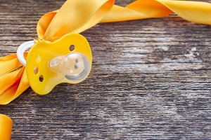 baby pacifier on wooden table