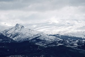 snowy peaks and clouds