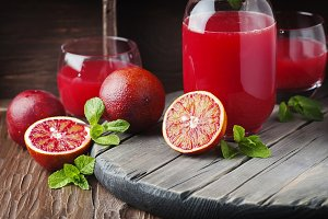 Delicious juice with red oranges
