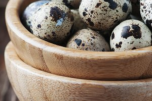 Quail eggs on the wooden table