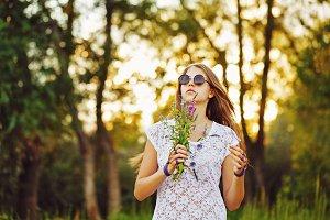 Boho Girl with bunch wildflowers