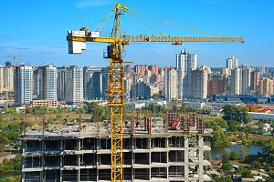 Construction crane and workers