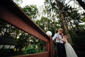 bride and groom posing on the verandah