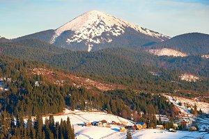 Mountains snow peak and village