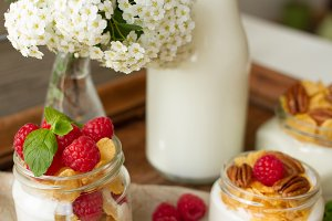 yogurt for breakfast with nuts, raspberry and milk.