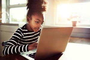 African-American School Girl Using her Laptop